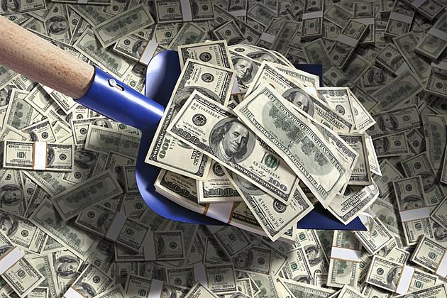 shoveling money