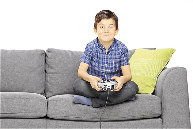 happy kid playing video games