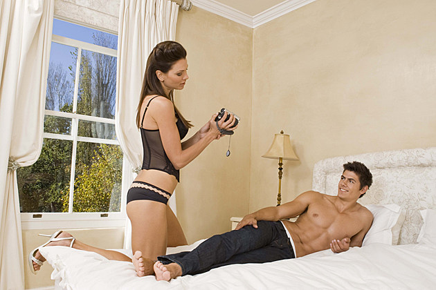 couple in bed with camera