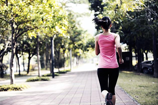 woman jogging pink shirt