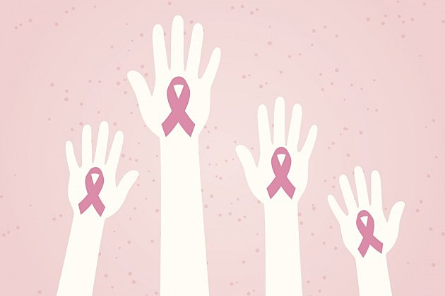 hands raised for breast cancer awareness