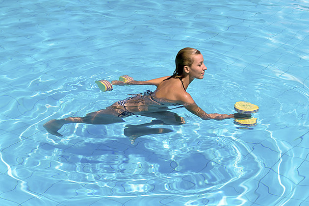 woman swimming with weights