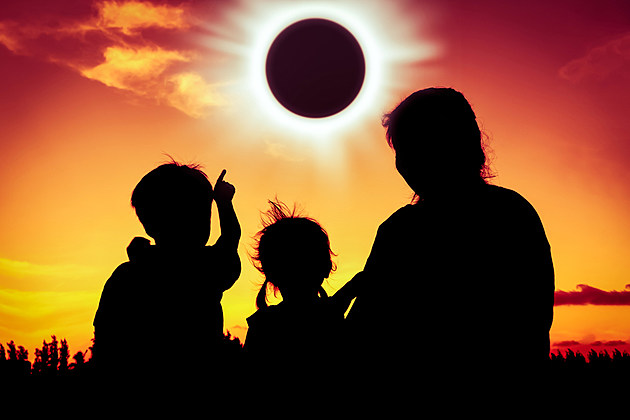 family watching solar eclipse