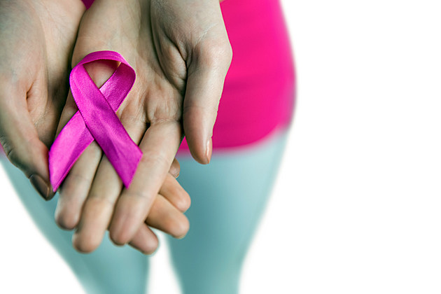 Woman with breast cancer ribbon